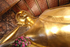 Reclining buddha gold statue face at wat pho in bangkok Stock Images
