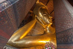 Reclining Buddha gold statue face Royalty Free Stock Images