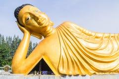 Reclining Buddha gold statue at Phuket, Thailand. Reclining Buddha gold statue at temple at Phuket, Thailand Stock Image
