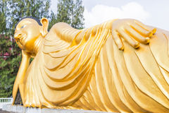 Reclining Buddha gold statue at Phuket, Thailand stock photo