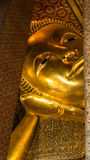 Reclining Buddha gold statue and thai art architecture Royalty Free Stock Photos