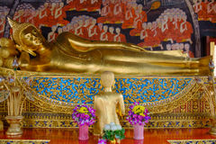 Reclining Buddha gold statue and thai art architecture in Wat Bovoranives, Bangkok, Thailand. Royalty Free Stock Photography