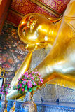 Reclining Buddha gold statue and thai art architecture. Royalty Free Stock Images