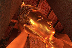 Reclining Buddha gold statue Royalty Free Stock Image