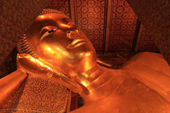 Reclining Buddha gold statue Royalty Free Stock Photography