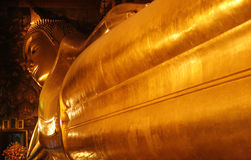 Reclining Buddha gold statue. Royalty Free Stock Image