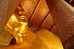Reclining buddha gold statue Stock Photos