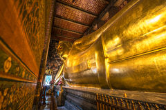 Reclining Buddha Gold Statue at Wat Pho, Bangkok, Thailand Royalty Free Stock Photography