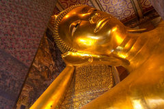 Reclining Buddha gold statue ,Wat Pho, Bangkok, Thailand Royalty Free Stock Images