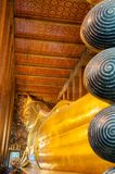 Reclining Buddha gold statue in Wat Pho buddhist temple Royalty Free Stock Image