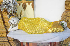 Reclining Buddha in a golden robe Stock Photos