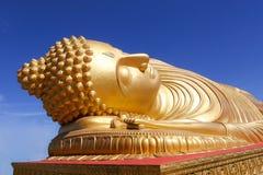 Reclining buddha. Golden reclining buddha statue Stock Photo