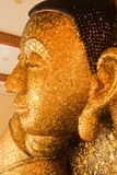 Reclining Buddha image covered with gold leaves Stock Images