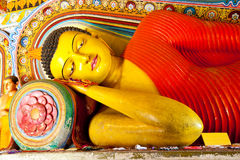 Reclining buddha in isurumuniya temple Royalty Free Stock Image