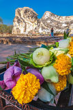 Reclining Buddha and Offering Flowers. Worshipers come to pray and offer flowers to the sleeping Buddha statue Royalty Free Stock Images