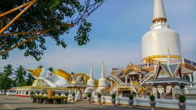 Reclining Buddha and pagoda in buddhist temple stock images