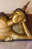 Reclining buddha statue. At Wat Pa Pradu,Rayong province Thailand Royalty Free Stock Photo
