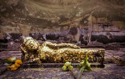 Reclining buddha statue in Ayutthaya, Thailand. Reclining buddha statue with gold leaf in Wat Lokayasutha temple, Thailand Stock Photography