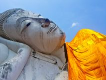 Reclining Buddha statue bottom-up view. stock photos