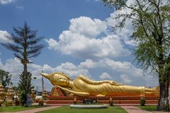 Reclining Buddha Statue at Buddhist Temple Next to Pha That Luang Stupa in Vientiane, Laos stock photo
