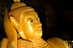 Reclining Buddha statue in cape in  Thailand. Royalty Free Stock Images