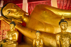 Reclining buddha statue in church Stock Images