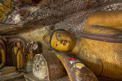 Reclining Buddha Statue Close Up In Dambulla Cave Temple, Sri Lanka Stock Photography