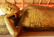 Reclining Buddha. Statue filled with gold sheet from people who faith in buddhism Stock Images