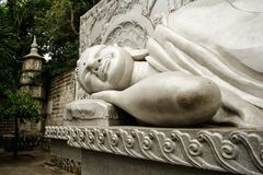 Reclining buddha statue at the Long Son Pagoda or Chua Long Son, a Buddhist temple in the city of Nha Trang in south Vietnam.  stock image