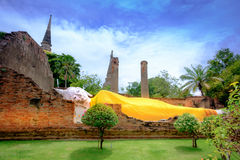 Reclining Buddha is a statue that represents Buddha lying down a Royalty Free Stock Image