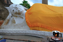 Reclining Buddha is a statue that represents Buddha lying down a Stock Image