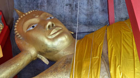 Reclining Buddha statue in rock cave Stock Photography
