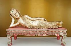 Reclining Buddha statue. Royalty Free Stock Photo