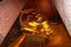 Reclining Buddha statue. Wat Pho, Bangkok, Thailand Royalty Free Stock Photo