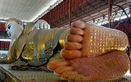 Reclining Buddha statue in Yangon, Myanmar stock images