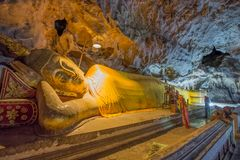 Reclining Buddha statues in Khao Luang Cave - Phetchaburi, Thailand. PHETCHABURI, THAILAND - SEPTEMBER 17: Reclining Buddha statues on September 17, 2015 in Khao stock photography