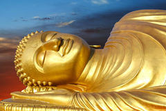 Reclining Buddha on sunset Royalty Free Stock Photography