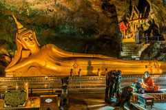 Reclining Buddha suwankuha temple Phuket thailand Royalty Free Stock Photo