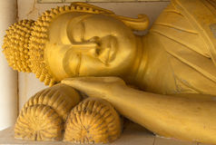 Reclining Buddha at Thai tample. Reclining Buddha and face Buddha at thai tample Royalty Free Stock Photo