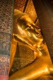 Reclining buddha of Thailand Stock Photos