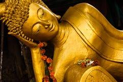 Reclining Buddha, Wat Haysoke, Vientiane, Laos. Golden reclining Buddha at Wat Haysoke in Vientiane, Laos Stock Photo