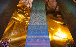 Reclining Buddha of Wat Pho. Wat Pho is one of famous temple in The Kingdom of Thailand. The main icon of this temple is its giant reclining Buddha Royalty Free Stock Photo