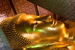 The reclining Buddha at Wat Pho in Bangkok Royalty Free Stock Image