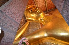 Reclining Buddha .Thailand. Detail of the Reclining Buddha in Wat Pho Temple , in Bangkok.Thailand royalty free stock image