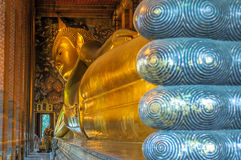 Reclining buddha, Wat Pho, Bangkok, Thailand. Asian landmark Stock Photos
