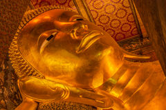 Reclining Buddha, Wat Pho, Bangkok of Thailand. Stock Photos
