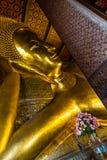 Reclining Buddha at Wat Pho Buddhist Monastry. Golden giant Reclining Buddha at Wat Pho Buddhist Monastry, Bangkok, Thailand Stock Image