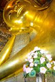 Reclining Buddha in Wat Pho Buddhist Temple in Bangkok, Thailand. The beautiful architecture of Wat Pho Buddhist Temple in Bangkok, Thailand stock photo