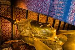 Reclining Buddha at Wat Pho Stock Images