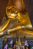 Reclining Buddha at the Wat Pho temple Stock Images